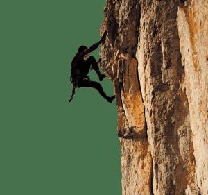 Uomo che scala la montagna